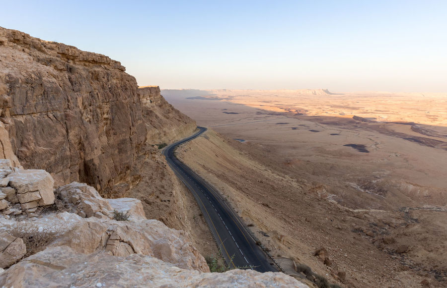 View from the mountain cliff at sunset on the Judean desert in Israel Light Natural Rock Scenic Skyline Sunny View Adventure Background Beauty In Nature Environment Israel Journey Judean Desert Landscape Mountain Mountain Cliff Park Scenics - Nature Sky Sun Sunset Tranquil Scene Tranquility Travel Destinations