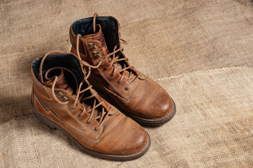 Shoe Pair Brown Leather Still Life Shoelace Indoors  Close-up High Angle View No People Two Objects Absence Boot Fashion Old Compatibility Day Menswear Dirt Lace - Fastener Boot Scraper Outdoors Hiking Boots Adventure