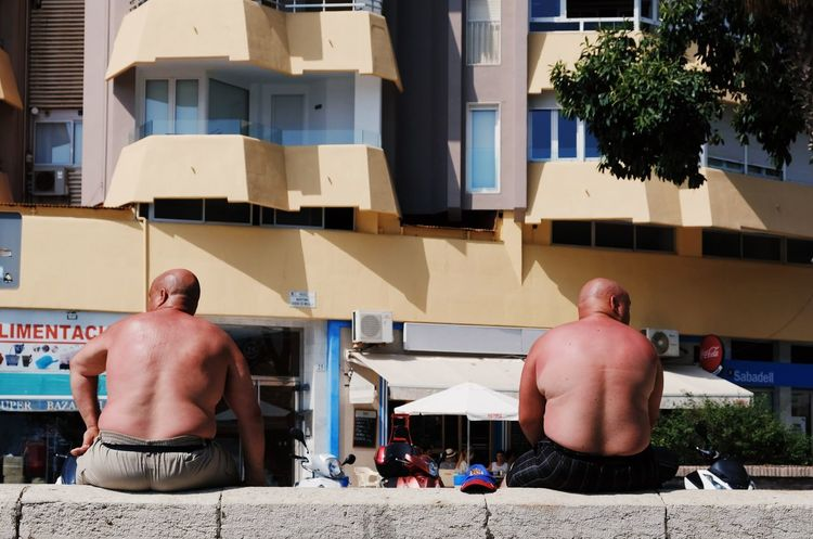 Just came back from a road trip though Andalusia/Spain. First stop: Malaga Building Exterior Built Structure City Day Human Back Leisure Activity Lifestyles Nature People Photography Real People Residential District Shirtless Street Photography Streetlife Streetphotographer Streetphotography Sunlight Urbanphotography