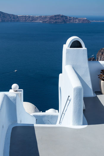 Sea Water No People Nature Day White Color Architecture Scenics - Nature Built Structure Sunlight Blue Nautical Vessel Outdoors Beauty In Nature Sky Railing Travel Destinations Building Exterior Travel Santorini Greece Aegean Sea Island Cyclades_islands Cyclades Tourism Caldera Mykonos Oia Oia Santorini