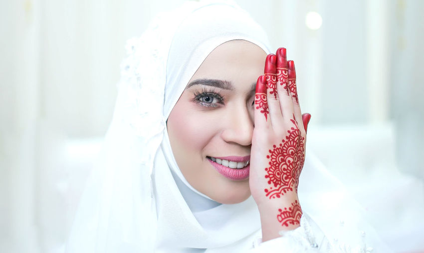 Portrait of young woman with henna tattoo