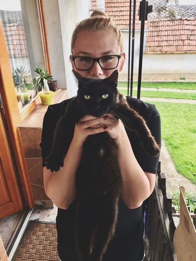 Black Cat Hungary Real People Lifestyles One Person Beard Leisure Activity Front View Sunglasses One Animal Home Interior Portrait Pets Day Dog Young Adult Domestic Animals Nature Indoors  Mammal Animal Themes