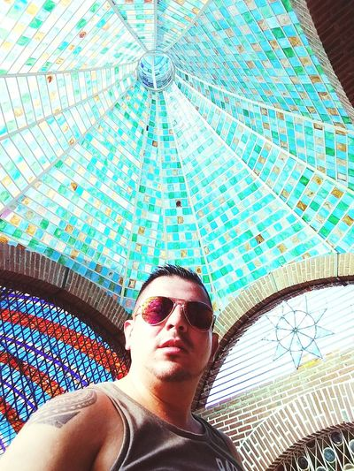 Low angle view of young man in sunglasses