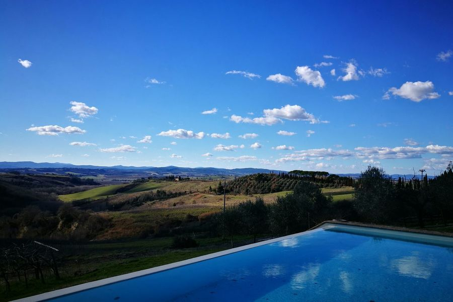 Water Nature Reflection Sky Swimming Pool Tourism Tree Cloud - Sky Day Outdoors Landscape Beauty In Nature Winter Sky Journey Runningaway No People Tranquillity Tuscany