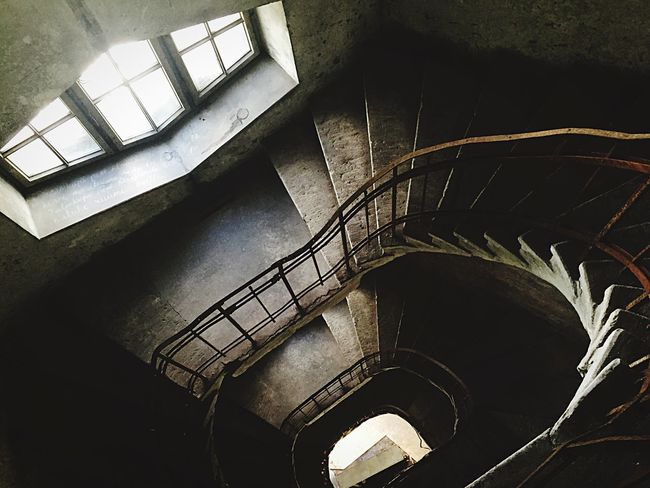 Spiral staircase in old abandoned factory Spiral Staircase Vertigo Staircase Vertigo Factory Steampunk Tallinn Shaft Stairs POVshots Geometric Shapes