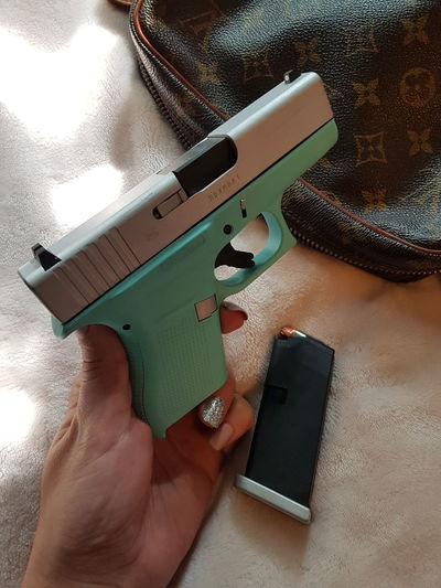 Fuck Gun Control No Filter No Filter, No Edit, Just Photography Gun GLOCK 9mm Turquoise Tiffany Bang Bang!!  Protection Self Update Thursday Bullets Louis Vuitton Feuer Frei Human Hand Holding Working High Angle View Close-up Personal Perspective Nail Polish Hand Tool Smart Phone