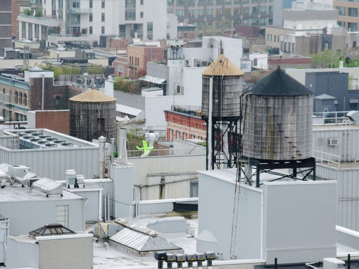 High angle view of water tanks on roof in city