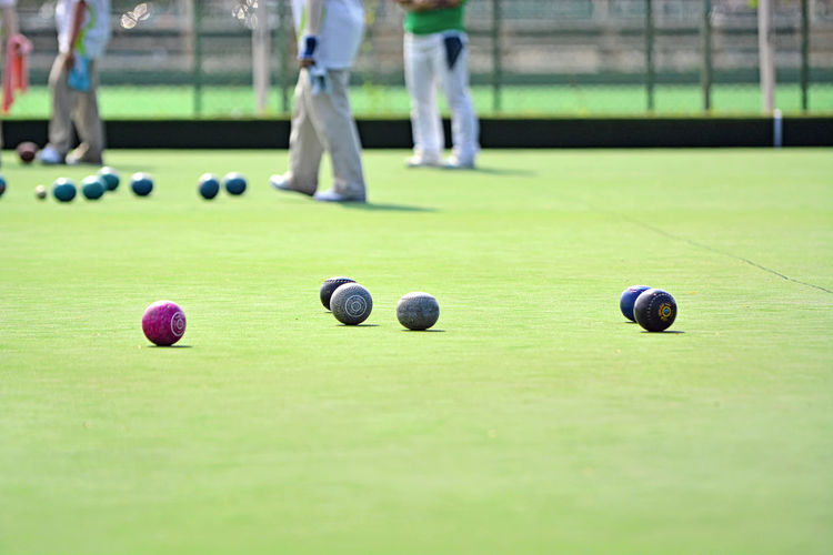 Lawn bowls on the green field Lawn Lawn Bowls Bowl Bowling Healthy Business Green Field EyeEm Selects EyeEm Best Shots EyeEmBestPics Eyeemphotography Outdoor Golfer Sportsman Golf Course Golf Club Soccer Field Golf Match - Sport Competition Sport Men Putting Green Yard