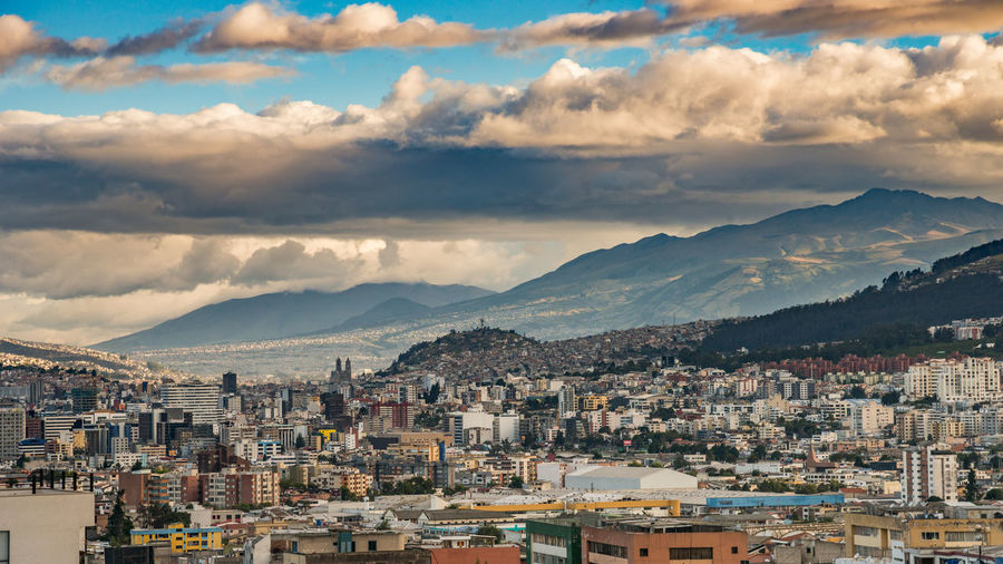 Quito QuitoEcuador Architecture Beauty In Nature Building Building Exterior Built Structure City Cityscape Cloud - Sky Crowded Day High Angle View Mountain Mountain Peak Mountain Range Nature Outdoors Residential District Scenics - Nature Settlement Sky TOWNSCAPE