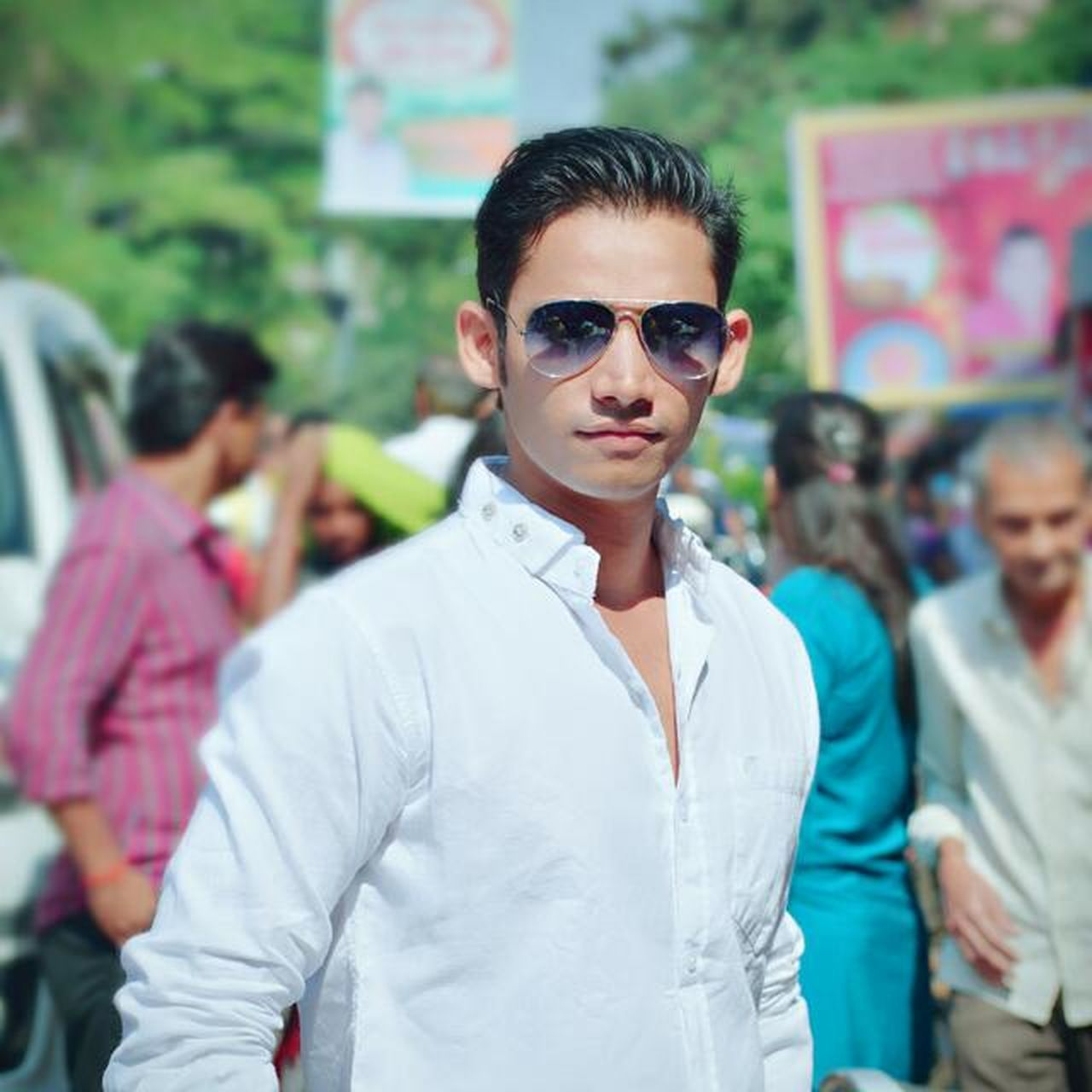 sunglasses, focus on foreground, portrait, looking at camera, young adult, young men, fashion, outdoors, day, standing, people, boys, one person, young women, adult, close-up