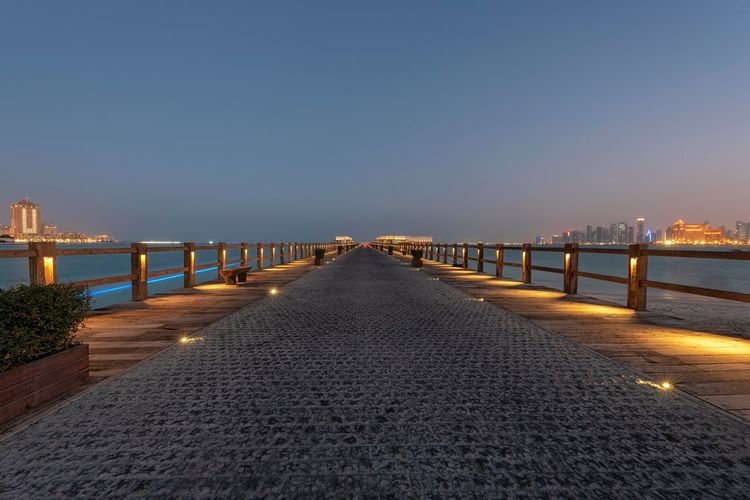 Marina Bridge Water Sky Sea Nature Architecture The Way Forward Built Structure Illuminated Direction Clear Sky Diminishing Perspective Tranquility Connection Copy Space Beach Railing No People City Tranquil Scene Outdoors