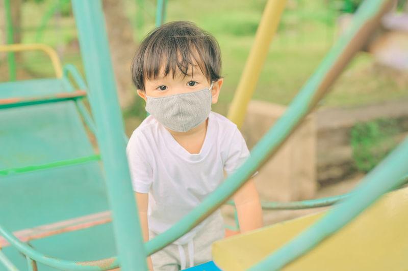 Portrait of cute boy in playground