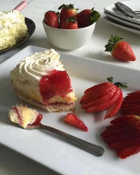 CLOSE-UP OF STRAWBERRY CAKE SERVED ON PLATE
