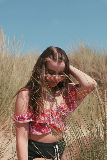 lets go to the beach Bikini Beach Portrait Young Women Beautiful Woman Beauty Beautiful People Arts Culture And Entertainment Long Hair Red Human Hair Posing Boho Countryside Blooming Growing Grassland In Bloom