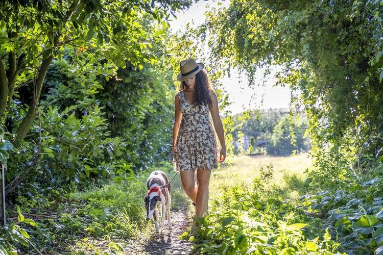 Woman with dog walking at park