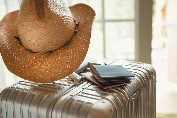 Hat Still Life No People Indoors  Focus On Foreground Close-up Table Technology Sun Hat Home Interior Day Security Clothing Straw Hat Protection Communication Metal Safety Window Personal Accessory Travel Vacation Tourism