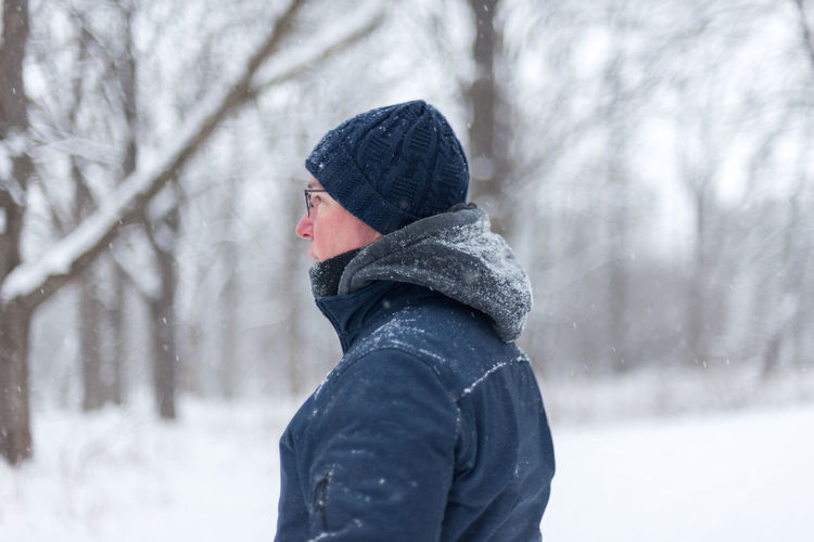 Man in warm clothing on snow covered land