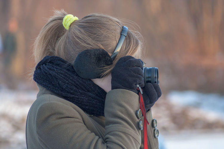 Girl with camera in winter Photographer Adult Blond Hair Bonding Cold Temperature Couple - Relationship Day Females Focus On Foreground Hair Hairstyle Leisure Activity Lifestyles Love Outdoors People Positive Emotion Real People Rear View Togetherness Two People Warm Clothing Winter Women First Eyeem Photo