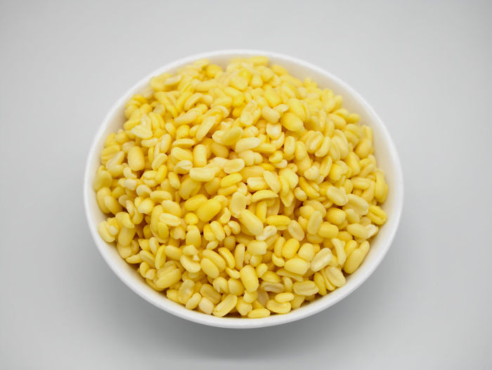 Close-up of yellow bowl over white background