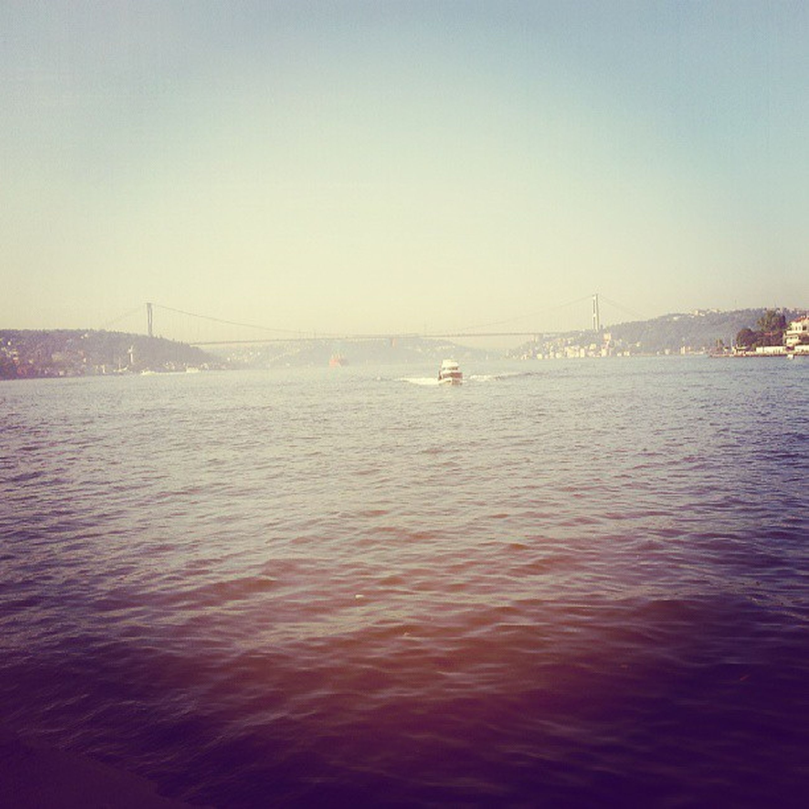 water, sea, waterfront, clear sky, transportation, built structure, copy space, architecture, connection, nautical vessel, bridge - man made structure, rippled, river, tranquility, tranquil scene, nature, scenics, engineering, beauty in nature, sky