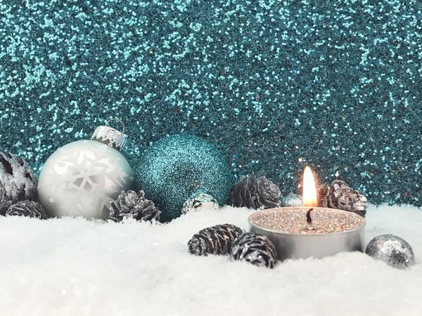 Christmas candle with decoration Winter Snow Candle Flame Cold Temperature Burning No People Christmas Christmas Decoration Snowing Studio Shot Glitter Copy Space Illuminated Day Close-up Advent Advent Candle Candlelight