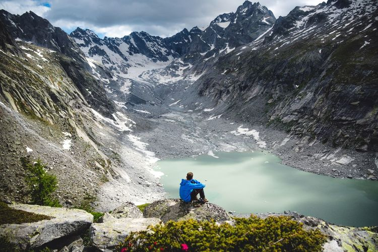 Enjoy the view Switzerland Leisure Activity Beauty In Nature One Person Mountain Lifestyles Real People Scenics - Nature Nature Plant Water Mountain Range Day Tranquil Scene Tranquility Sky Non-urban Scene Adventure Rear View Outdoors