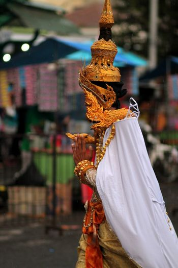 Side View Of Woman Wearing Traditional Clothing