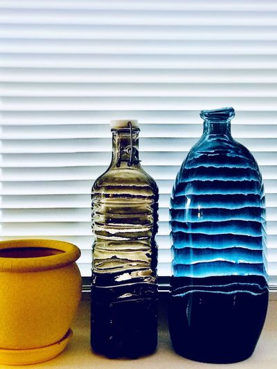 Glass decoration and bottles Vase Bottle Bottle Container Indoors  Still Life Food And Drink No People Table Arrangement Choice Glass - Material Close-up Variation Side By Side White Background