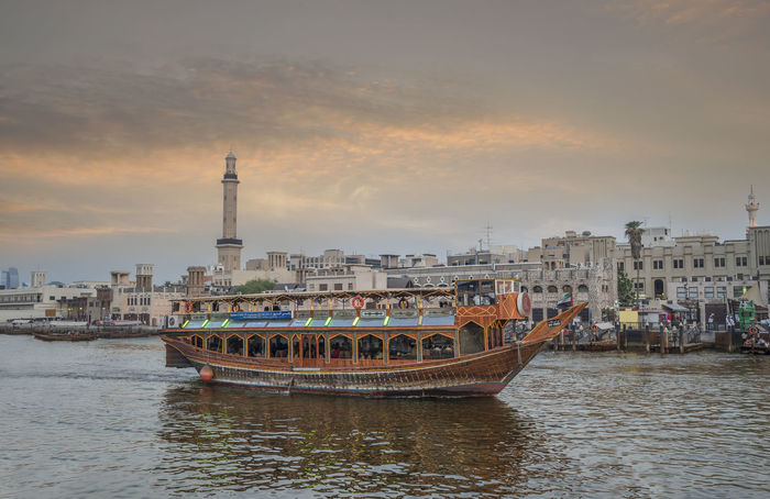 Dhow on Dubai Creek Architecture City Cityscape Day Downtown Dubai Dubai Creek Nautical Vessel No People Outdoors Sky Traditional Transportation Travel Destinations Water