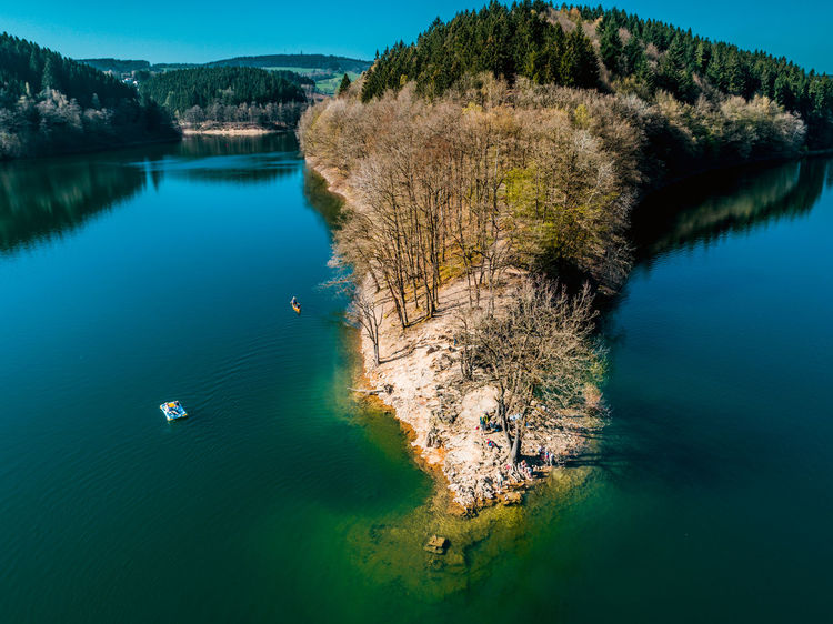 Beauty In Nature Day High Angle View Lake Landscape Mountain Nature Nautical Vessel No People Outdoors Scenics Sky Tranquil Scene Tranquility Tree Water