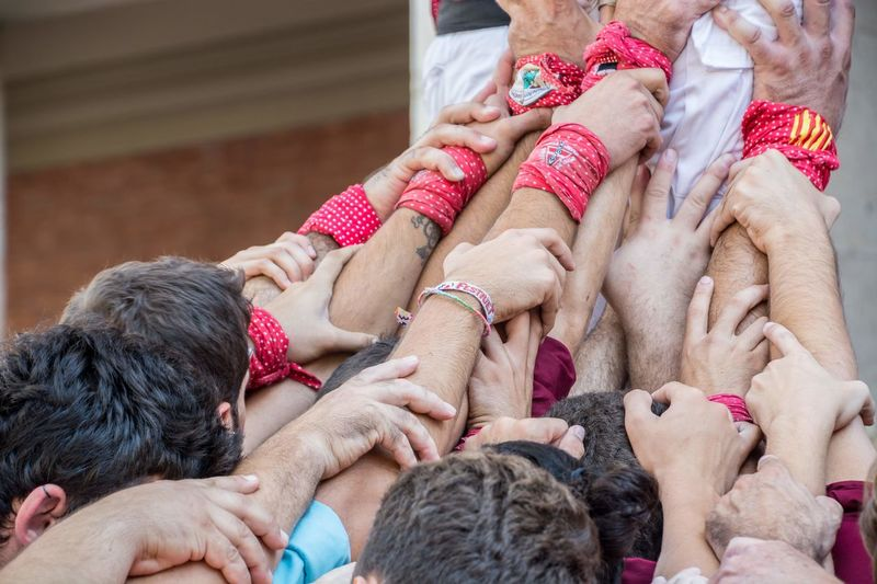 Castellers de Vilaseca building a Human Tower Human Towers Teamwork Adult All Together !!! Body Part Castellers Castellers De Vilaseca Child Day Emotion Family Focus On Foreground Give Me A Hand Group Of People Hand Holding Human Body Part Human Hand Lifestyles Love Men People Positive Emotion Real People Togetherness Women