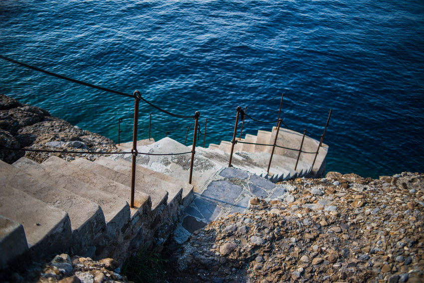 Hiking Nature Rock Formation Stairs Steps Toursim Traveling Vacations Water Reflections Adventure Blue Liguria Outdoors Punta Chiappa Railings Rock - Object Sea Stone Water Waterfront
