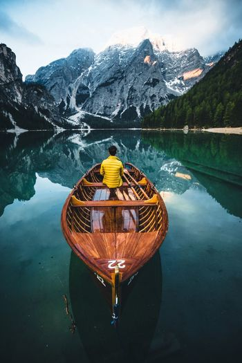 Boat ride in Italy. Braies Dolomites, Italy Water Mountain Beauty In Nature Scenics - Nature Lake Mountain Range Nature Tranquility Tranquil Scene Reflection Winter Sky Day Non-urban Scene Tree Cloud - Sky Transportation Nautical Vessel Plant No People