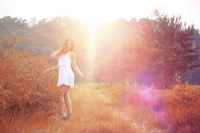 Sunlight White Dress Beautiful Woman Beauty In Nature Casual Clothing Fashion Field Full Length Growth Hair Hairstyle Leisure Activity Lens Flare Lifestyles Long Hair Nature One Person Outdoors Plant Real People Tree Wahnerheide Women Young Adult Young Women