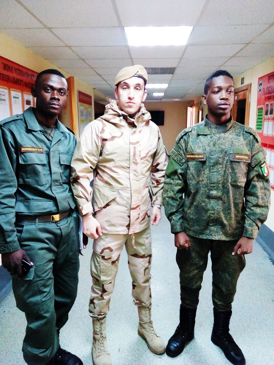 front view, standing, full length, real people, men, young adult, togetherness, military uniform, helmet, indoors, day, camouflage clothing, people