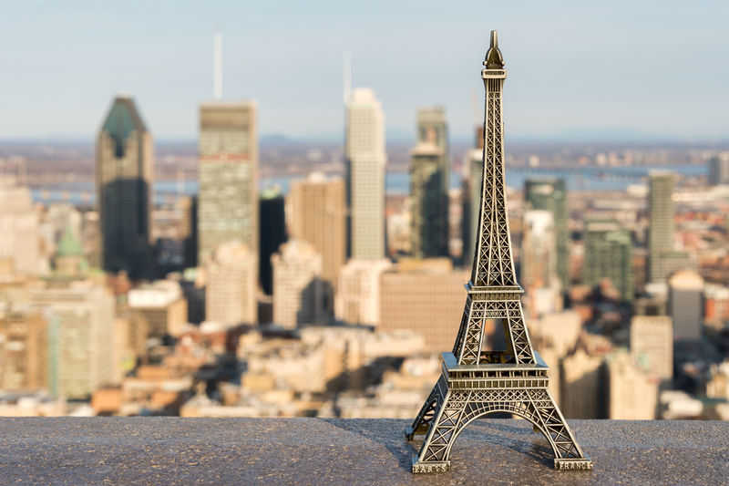 Close-up of eiffel tower against cityscape