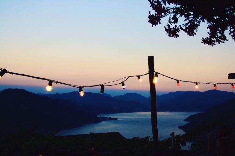 After The Sunset Sunset Colorful Summer Night Late Summer Night Late Summer Blue Sky Lago Maggiore Ticino Sky Silhouette Nature Water Beauty In Nature Scenics - Nature Mountain Tranquility Sunset No People Tranquil Scene Non-urban Scene Clear Sky Plant Lighting Equipment Sea Outdoors Copy Space Tree
