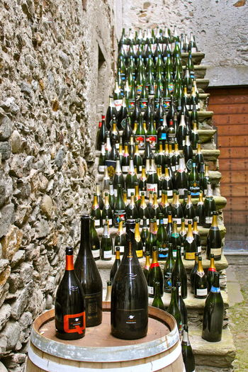 Close-up of wine bottles on wall
