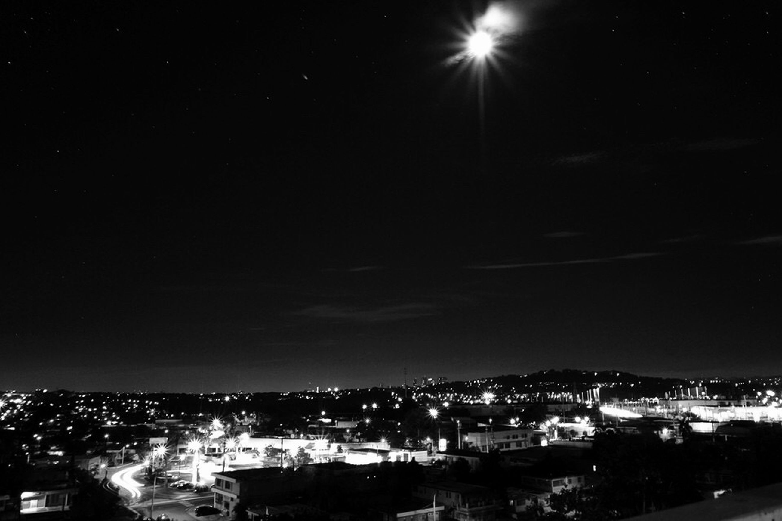 night, illuminated, cityscape, city, building exterior, built structure, architecture, moon, sky, crowded, high angle view, residential district, dark, aerial view, residential building, residential structure, outdoors, scenics, landscape, no people