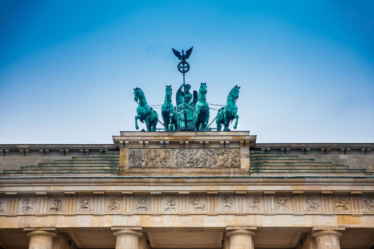 Low angle view of brandenburg gate against blue sky