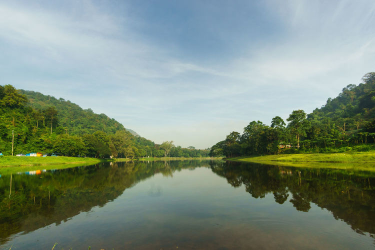 Water Tree Reflection Sky Tranquility Scenics - Nature Tranquil Scene Lake Plant Beauty In Nature Green Color Nature Non-urban Scene Cloud - Sky Day Waterfront Idyllic No People Outdoors Reservoir Dam Reservoir View Reservoir Reflection Tropical Forest