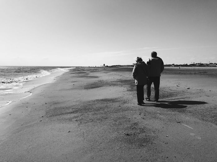 Beach Sand Sea Full Length Real People Shore Two People Rear View Togetherness Nature Men Horizon Over Water Clear Sky Walking Leisure Activity Tranquility Water Standing Outdoors Lifestyles Skegness IPhoneography