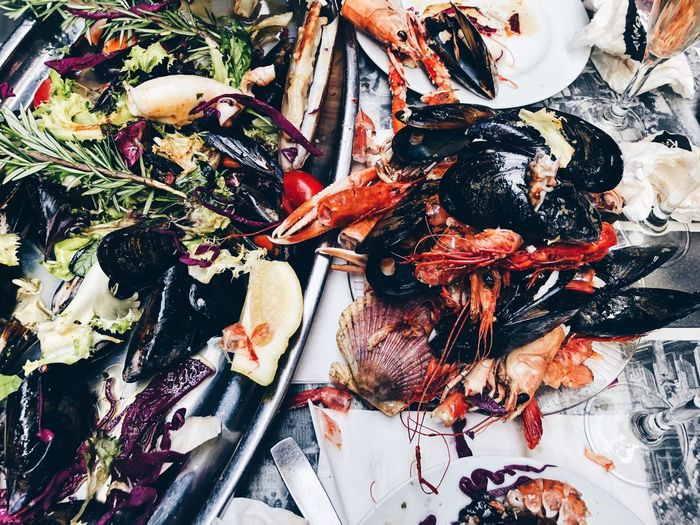 seafood platter aftermath Seafood Food And Drink Food Crustacean Freshness Healthy Eating Wellbeing Mussel No People Animal High Angle View Prawn Indoors  Vertebrate Still Life Close-up Fish Ready-to-eat Directly Above Meat Dinner Shrimp Mussles Shells Leftovers