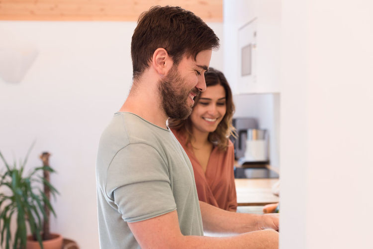 Young couple smiling at home