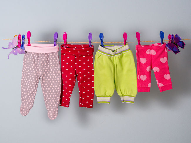 Toddler´s pants on the clothline Arranged Baby Casual Clothing Child Close-up Clothes Clothing Clothline Coathanger Collection Fabric Growing Hanging Indoors  Indoors  Kids No People Pan People Row Textile