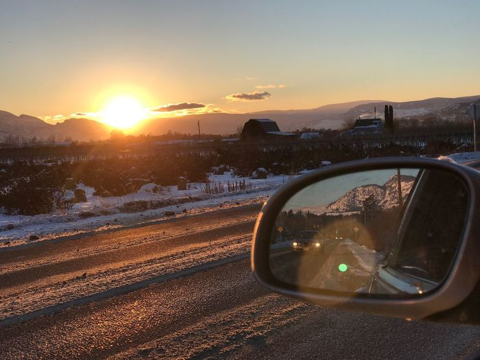 Sunset Transportation Car Sun Nature Sky Road Winter Snow Cold Temperature Mountain No People Beauty In Nature Scenics Outdoors Close-up Reflections And Shadows ReflectionPerfection! Roadside Reflection Mirror Reflection Mirror Picture Car Ride  Transportation Vintage Style , A Different Perspective Traveling Home For The Holidays