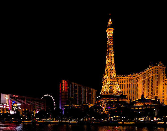 Las Vegas Skyline at Night Copy Spacke Las Vegas París Hotel-Las Vegas, Nevada Architecture Building Exterior City Illuminated Nevada Night No People Outdoors Sky Tourism Tower Travel Destinations Paint The Town Yellow