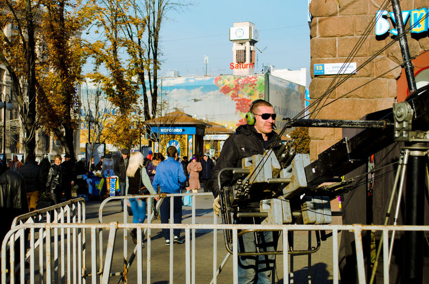 """Shooting a music show """"Karaoke on the Maidan"""" in Kiev, Ukraine. Camcorder City City Life Day Job Kiev Ukraine Lifestyles Man Men Occupation Operator People People Watching Proffesional Real People Show Sity Street Street Photography Streetphotography Sunny Day Town Tv Video Videoshoot"""