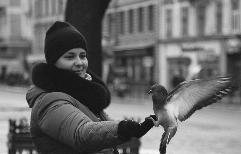 Portrait of a woman with pigeon