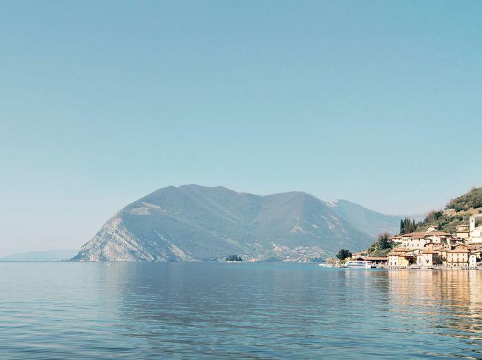 Lombardia Water Mountain Sea Clear Sky Nautical Vessel Beach Blue Sky Architecture Building Exterior